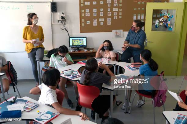 Mr. Ros, brother of the photographer, and Maria Fabregas co-teachers of Eso 1 on the first day of school at Vedruna Angels School in Raval...