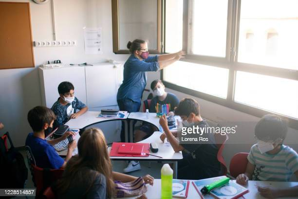 Mr. Ros, brother of the photographer, teachers of Eso 1, opens a window on the first day of school at Vedruna Angels School in Raval neighborhood on...