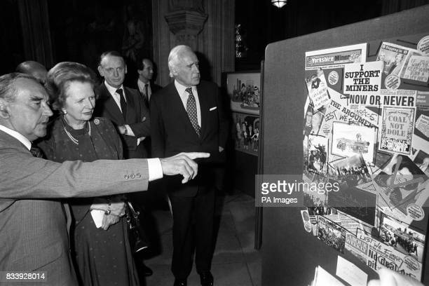 Mr Roy Mason Labour MP for Barnsely Central points out to Premier Margaret Thatcher his montage Lest We Forget in an art exhibition of works by MP's...