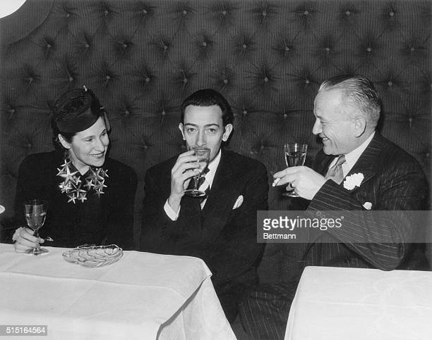 Mr Salvador Dali and Mrs Gala Dali enjoy a glass of champagne with Jacques Bollinger the Champagne King of France at a party given in the honor of M...
