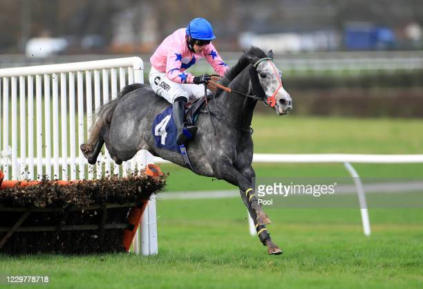 Mr Shady ridden by jockey Ryan Mania clears the last fence on the way to finishing second in the wetherbyracing.co.uk Juvenile Maiden Hurdle at...