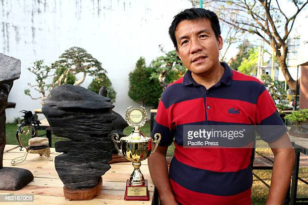 Mr Sonny Armamento with his Cliff Stone Best in Show in Suiseki Cathegory in The First Bonsai and Suiseki Exhibit Competition presented by the City...