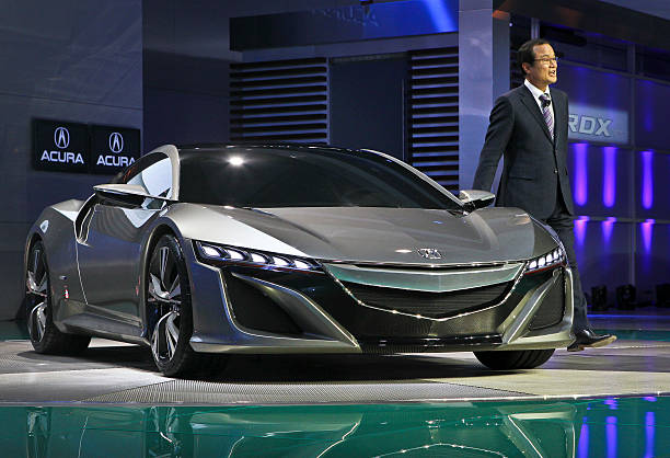 Mr Takanobu Ito President And CEO Of Honda Motor Company Stands With The Acura