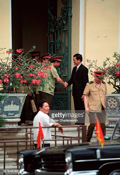 Mr Troung Tan Sang Chairman of the People's Committee of Ho Chi Minh City says goodbye to some visiting military dignitaries on the steps of the...