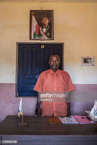 Mr. Vahovelo Sonja, 61 years old, mayor of the commune of Sampona, poses for a portrait in his office in the commune of Sampona, on August 31, 2021....