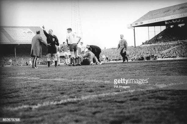 Mr von Ravens the Dutch referee orders off one of three trainers who raced on to the pitch when SV Hamburg goalkeeper Ankos Oezcan was injured early...