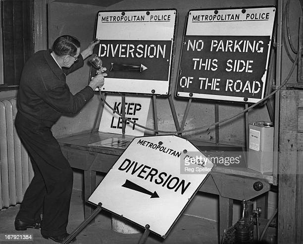 Mr W Bewley of Camberwell spraying the traffic sign boards at the Traffic Signal department at Rochester Row Police Station The signs will be used to...