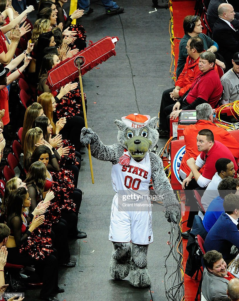 Mr. Wuf, mascot of the North Carolina State Wolfpack, enjoys the last few seconds of a win over the North Carolina Tar Heels at PNC Arena on January 26, 2013 in Raleigh, North Carolina. North Carolina State won 91-83.