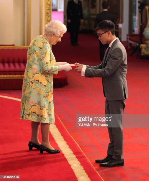 Mr Yi Jun Mock from Singapore receives his Young Leaders Award from Queen Elizabeth II during a ceremony in the Ballroom at Buckingham Palace