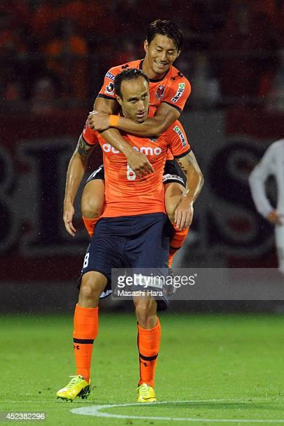 Mrdja and Akihiro Ienaga of Omiya Ardija celebrate the second goal during the J. League 2014 match between Omiya Ardija and Sandrecce Hiroshima at...