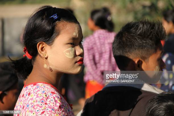 Mro ethnic women with children displaced from the surge of fighting between ethnic armed rebel group of the Arakan Army and government troops take...