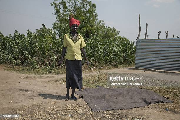 JANUARY 30 2014 Mrs Agon Diop on the side of Mr Malak Maathok an old and blind man a relative shot down in the district of Marol close to the city...