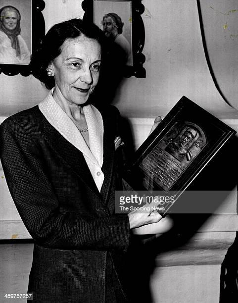 Mrs Aimee Alexander and holds plaque wife of Grover Cleveland Alexander circa 1951