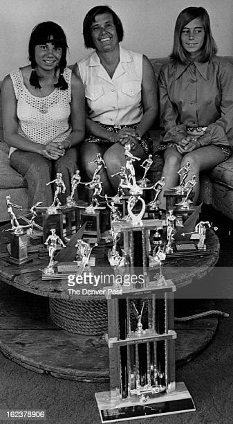 Mrs. Alan Vogan, center, and daughters, Karla, left, and Leslie this month added 10 trophies to family's collection with wins at Grand Lake Sunrise...