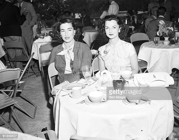 Mrs Alfred G Vanderbilt and Mrs John Sims Kelly sitting at table Hileah Race Track Florida c1945