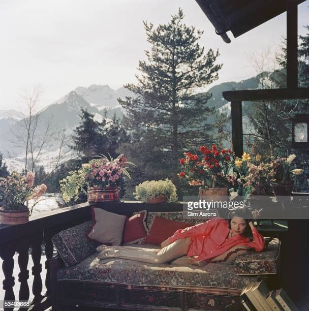 Mrs Alfredo Cernadas reclines on a balcony in Gstaad, 1977.