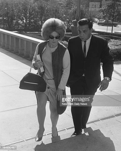 Mrs Alice Crimmins and her attorney Harold C Harrison arriving at Criminal Courts building in Kew Gardens Att'y Harrison asked for a postponement...