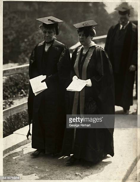 Mrs Andrew Carnegie and Mrs Finley Shepard are shown in caps and gowns walking at a graduation ceremony
