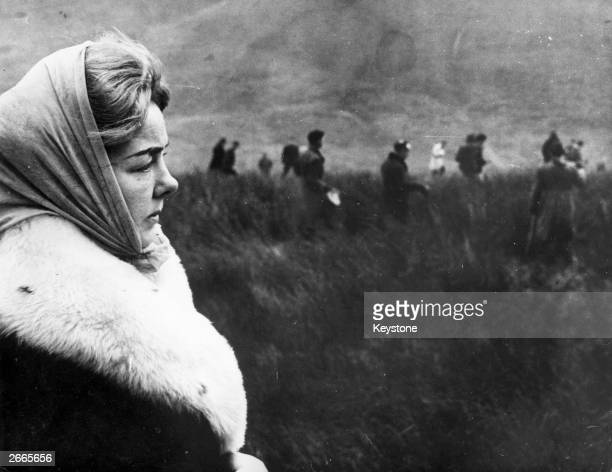 Mrs Ann Downey watching the police search Saddleworth moors for the body of her daughter Lesley a victim of the Moors Murderers Ian Brady and Myra...