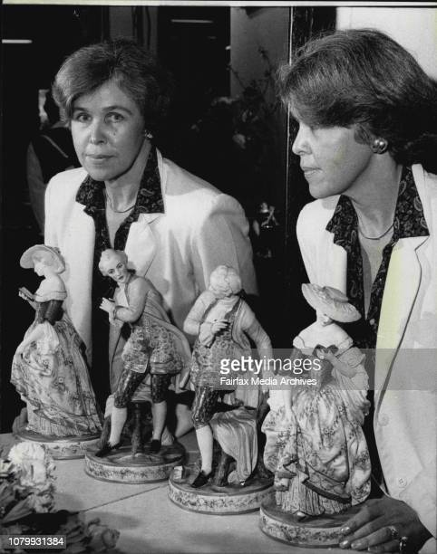 Mrs Ann Griffin of Turramurra at the Fraser Antique display with two Porcelain figures made in Australia around the 1870s They are reflected in a...