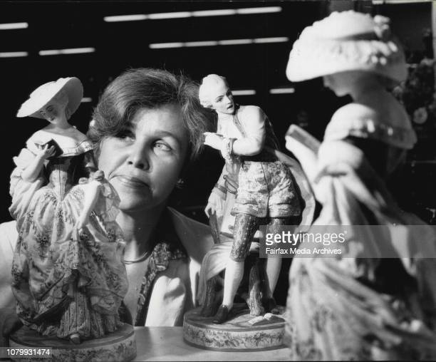 Mrs Ann Griffin of Turramurra at the Fraser Antique display with two Porcelain figures made in Australia around the 1870s/ They are reflected in a...