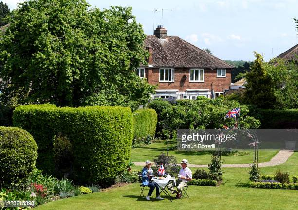 Mrs Anna and Mr Tony Botterill, parents of the photograpgher enjoy afternoon tea in their garden on May 08, 2020 in Northampton, United Kingdom. The...