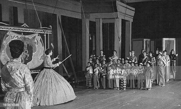 JUL 18 1957 Mrs Anna Leonowens the schoolteacher shown with the blackboard pointer teachers the King's children to sing an English song