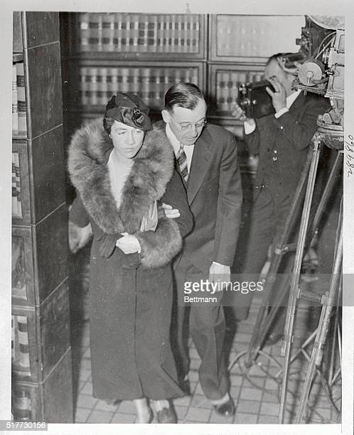 Mrs Anne Morrow Lindbergh and Robert Peacock Assistant Attorney General pictured as they arrived at the Hunterdon County Courthouse at Flemington New...