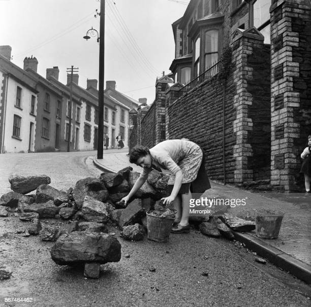 Mrs Annie Berry takes in her coal which is delivered in a heap in the street Stanleytown Rhondda Cynon TafWales 1st March 1954