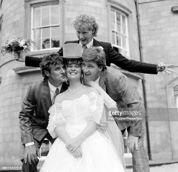 Mrs Ashley Grimes enjoying the attention of Manchester United's Kevin Moran and Norman Whiteside as her new husband looks surprised following their...