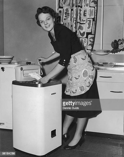 Mrs Audrey Marland of Bowden in Cheshire, the north-west finalist in the Bride of the Year contest, 1st November 1955. Here she dries the laundry...