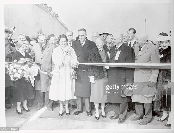 Mrs. Averill Harriman, wife of New York's governor, is shown cutting the tape to officially open the three mile New York State Thruway Bridge over...