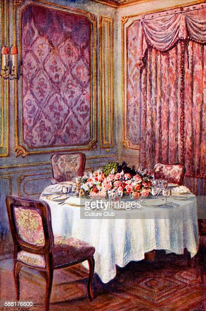 Mrs Beeton s cookery book dinner table Caption reads The floral decorations are kept low to facilitate conversation New edition of the cookerybook...