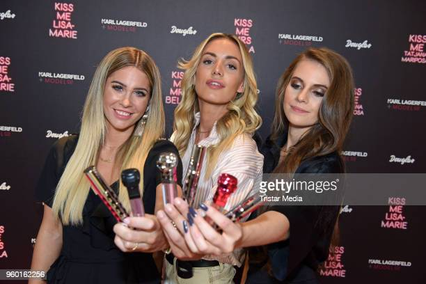 Mrs Bella Tatjana Mariposa and LisaMarie Schiffner during the 'Kiss Me Karl Limited Edition' Launch at Douglas Store on May 19 2018 in Berlin Germany