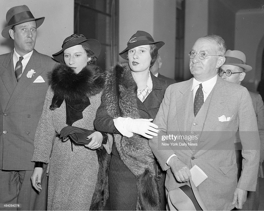 Mrs. Benjamin Thaw, the former Consuelo Vanderbilt; her sister, Mrs. Gloria Morgan Vanderbilt, and the latter's counsel, Nathan Burkan as they appeared in Supreme Court. The man at the left is unidentified.
