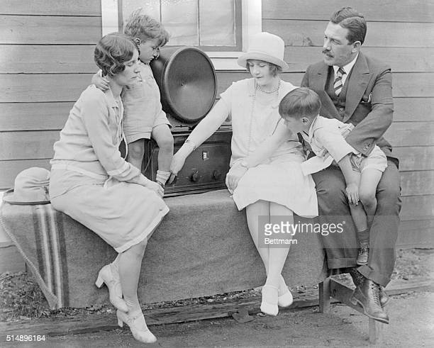 Mrs Bert Acosta and sons Allen and Bert Jr Mrs Noville and Grover Whalen listening to the radio