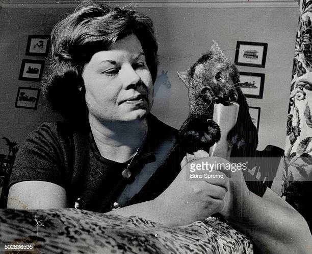 Mrs Betty Ikeda with her sillgrowing jaguarundi The fishhating pet likes nothing better than a dive into the bathtub