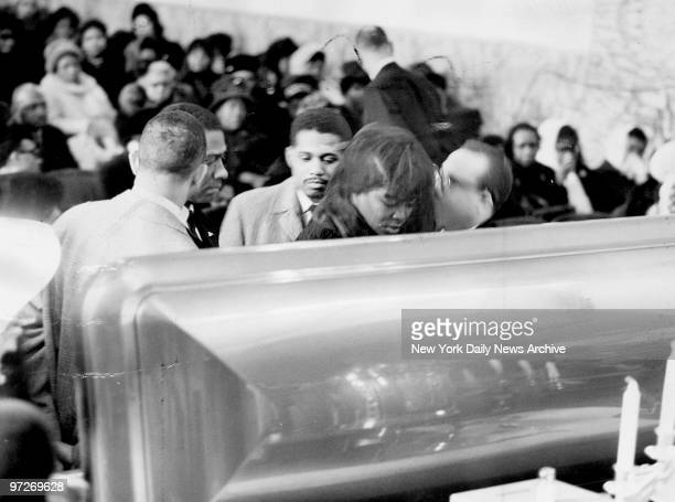 Mrs Betty Little Shabazz widow stands in front of casket during Malcolm X funeral at the Church of God in Christ