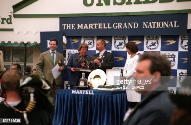 Mrs Betty Moran receives a trophy as the owner of the 2000 Martell Grand National winner Papillon