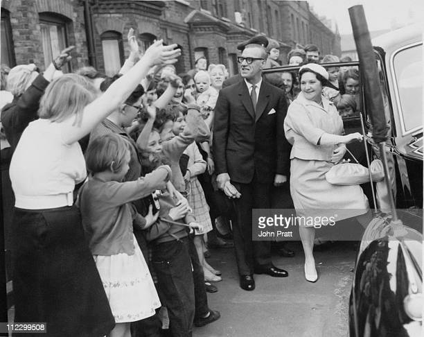 Mrs Betty Peabody former housekeeper to Antony ArmstrongJones waves goodbye to her neighbours in Trollope Street Battersea London as she leaves to...