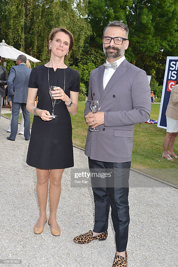 Mrs Cantin from British Embassy of Paris and Fashion designer Nicolas Oakwell attend the British 'Summer Time 2015' :Cocktail At the British Embassy And Shops Events Rue du Faubourg Saint Honore on June 11, 2015 in Paris, France.