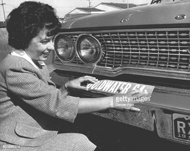 Mrs Carmen Lawrence 10460 W 7th place pastes on bumper sticker which boosts the presidential candidacy of Sen Barry Goldwater Credit Denver Post