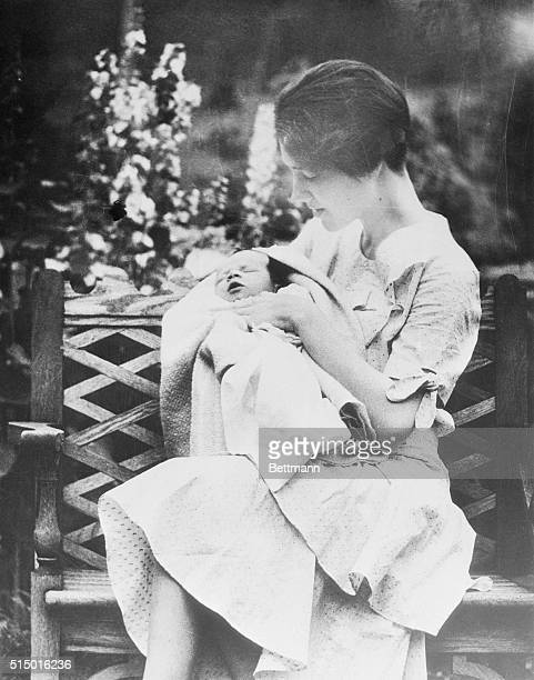 Mrs Charles A Lindbergh holding her son Charles Augustus Lindbergh Jr This photo was made by his illustrious aviator father