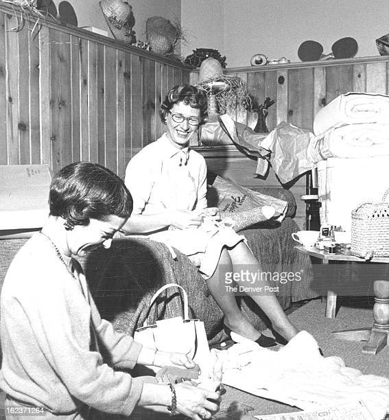 PATTERN Mrs Charles Yeoman studies a pattern to match the stocking bunny's head to his body with approval by Mrs Jack Anderson feathering seams on a...