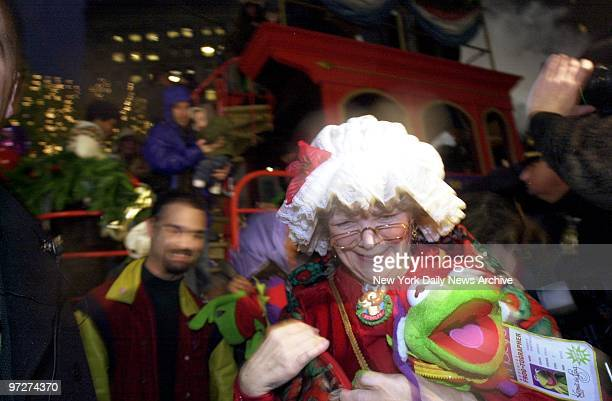Mrs Claus hugs a stuffed Kermit the Frog as she steps off the Santaland Express train in Macy's Herald Square This year's holiday windows which were...