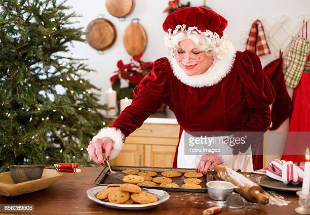 Mrs. Claus making gingerbread cookies