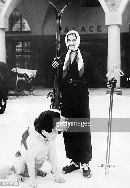 Mrs Clementine Churchill with her Saint Bernard during her winter holidays in St Moritz Photograph 1937