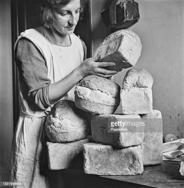 Mrs Daisy Towner, the wife of a farm labourer, checks her allocated 4 days ration allowance of bread to feed her family of six at home in East...