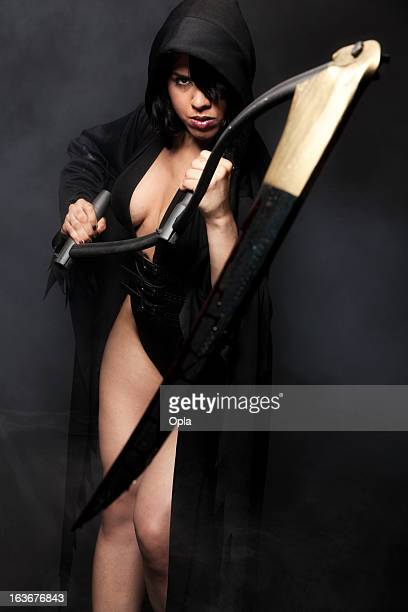 mrs. death holding a scythe - grim reaper stock pictures, royalty-free photos & images