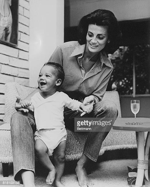 Mrs Delores Williams wife of baseball's famed Ted Williams plays with her six month old son John at thier home in the Florida Keys The former beauty...